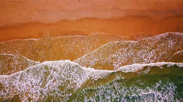 Aerial View Of Waves Crashing On A Beach