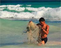 Fisherman With Casting Net In Tulum Mexico