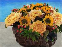 Centerpiece Consisting Of Roses, Sunflowers, And Berries