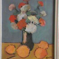 Flowers And Oranges On The Table