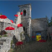 Red Umbrellas Into Old Church