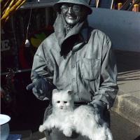 Automat With White Kitten