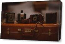 Four Vintage Cameras And A Suitcase As Canvas